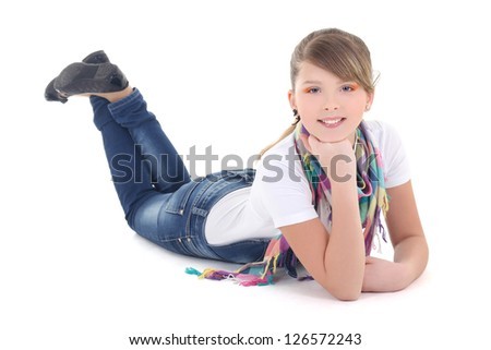 beautiful teenager lying over white background