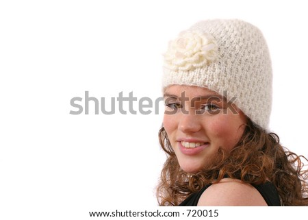Beautiful teenager with white winter hat