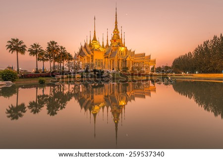 Beautiful temple at twilight time in Thailand - stock photo