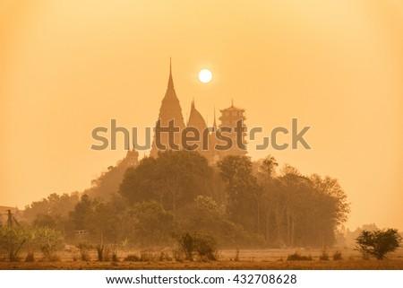 beautiful temple in Thailand at sunrise scenewat tum sua temple , most popular temple in Kanchanaburi , Thailand - stock photo