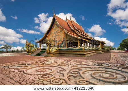 beautiful temple in Thailand with blue sky - stock photo