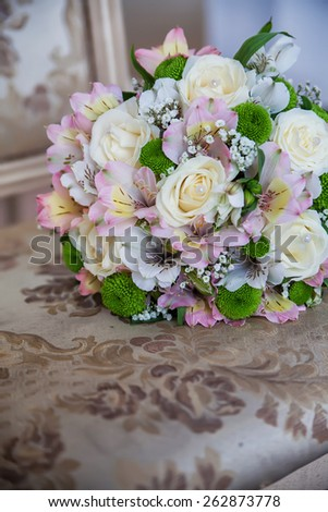 beautiful tender bridal bouquet from different roses and other flowers close up