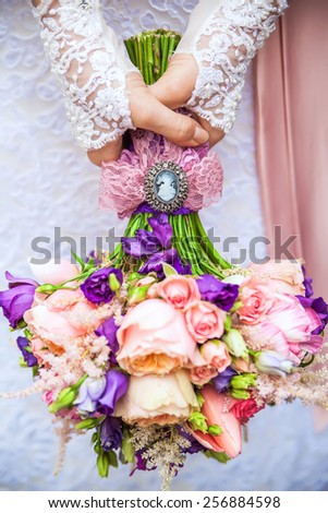 beautiful tender bridal bouquet of roses holding bride - stock photo