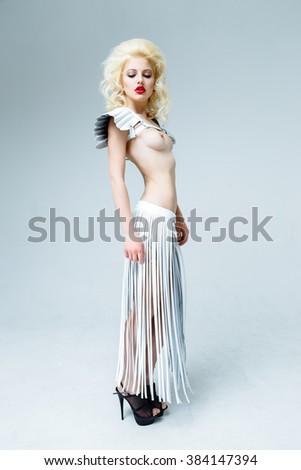 Beautiful tender woman with blonde hair posing - stock photo