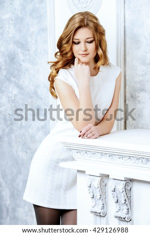 Beautiful tender young woman with magnificent long wavy hair. Bride portrait. Wedding. Beauty, fashion. Cosmetics. - stock photo