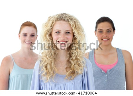 Beautiful tennage girls smiling against white background