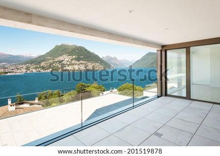 beautiful terrace in a modern penthouse, lake view  - stock photo