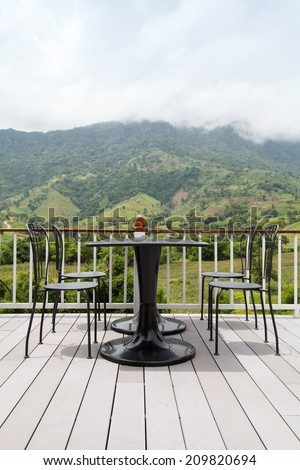 Beautiful terrace lounge with mountain view - stock photo