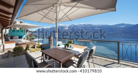 beautiful terrace of a luxury house, lake view - stock photo