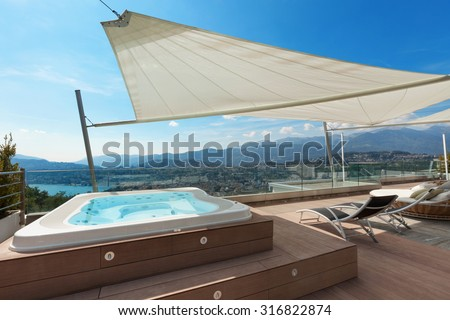 beautiful terrace of penthouse with jacuzzi - stock photo