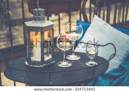 Beautiful Terrace Or Balcony With Cozy Rattan Armchair And Candles On Small  Iron Table On Small