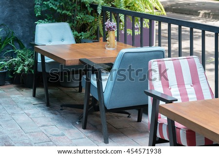 Beautiful terrace or balcony with small table, chair and flowers.   - stock photo