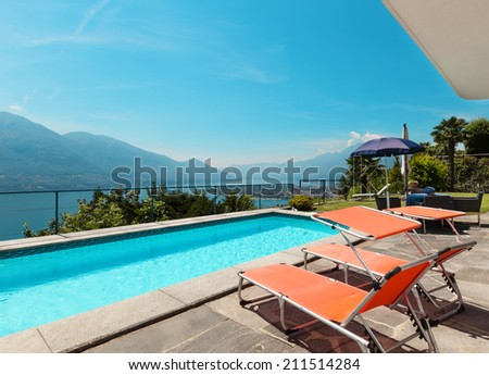 beautiful terrace with swimming pool in a villa on the lake