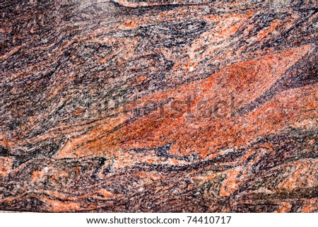 Beautiful texture of red-colored natural granite. - stock photo
