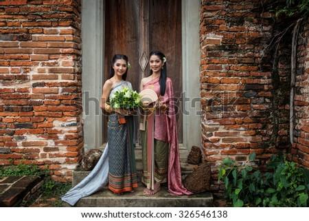 Beautiful Thai girl in Thai traditional costume,at watputthaisawan,Ayutthaya,Thailand. - stock photo