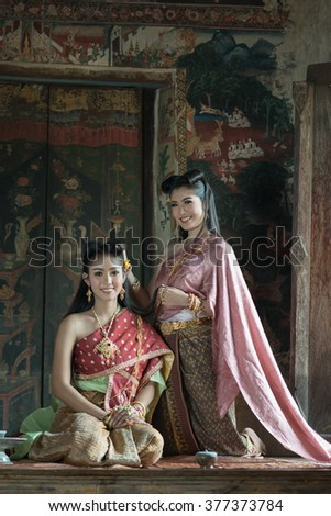 Beautiful Thai lady in Thai traditional dress  - stock photo