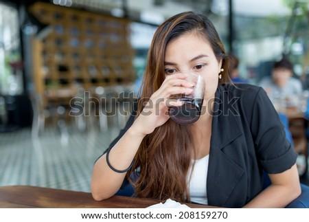 beautiful thai woman drinking coke - stock photo