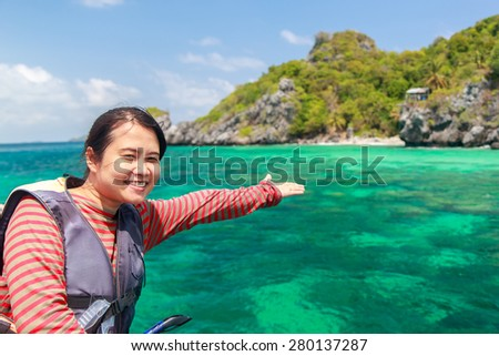 Beautiful Thai woman on the boat at Langka Jew Island It is located in the Gulf of Thai, Chumphon Province, Thailand