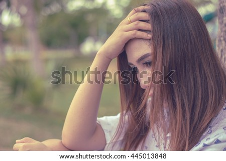 Beautiful thai woman very sad from unrequited love,rethink,think over,vintage style - stock photo