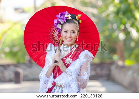 Beautiful Thai women with smiley face. - stock photo