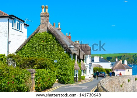 Beautiful Thatched Cottaged covered in Ivy - stock photo
