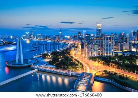 beautiful the bund and huangpu river in shanghai at nightfall, China  - stock photo