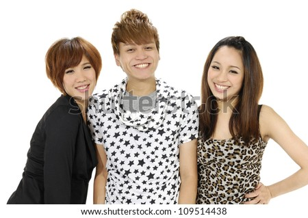 beautiful thee friends posing ; man and two woman around he - stock photo