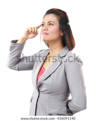 Beautiful thinking Asia business woman looking up isolated on white background. - stock photo