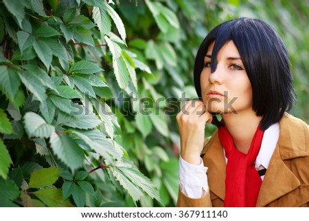 Beautiful thoughtful girl anime character near the leaves in the park