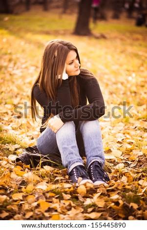 beautiful thoughtful girl  in autumn park - stock photo