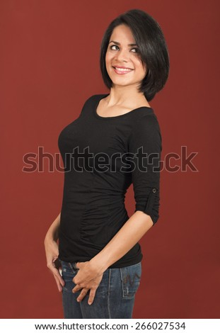 Beautiful thoughtful latin woman smiling isolated over a red background - stock photo