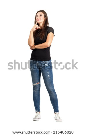 Beautiful thoughtful pensive woman looking up. Full body length isolated over white. - stock photo