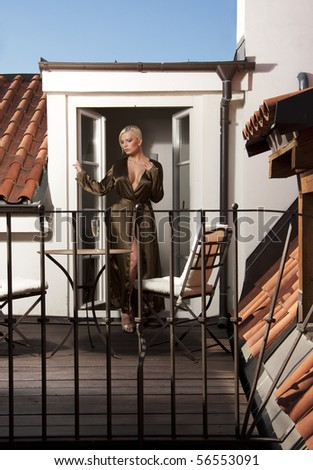 beautiful thoughtful sad woman on terrace - stock photo