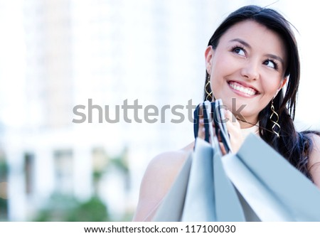 Beautiful thoughtful woman shopping looking very happy