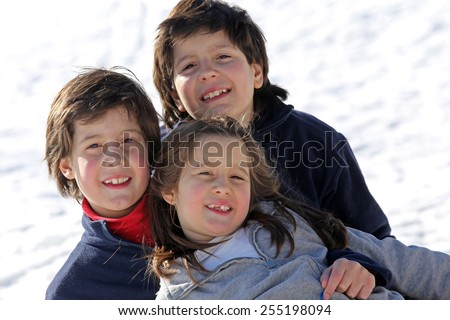 beautiful three brothers in the snow in winter - stock photo