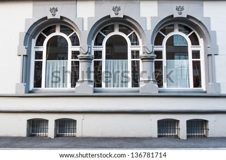 Beautiful Three windows on white wall - stock photo