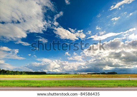 Beautiful thunderstorm clouds over the road - stock photo