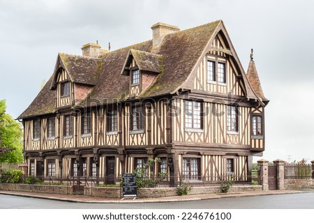 Beautiful Timber frame building with garden in Beuvron en Auge, Normandy, France - stock photo