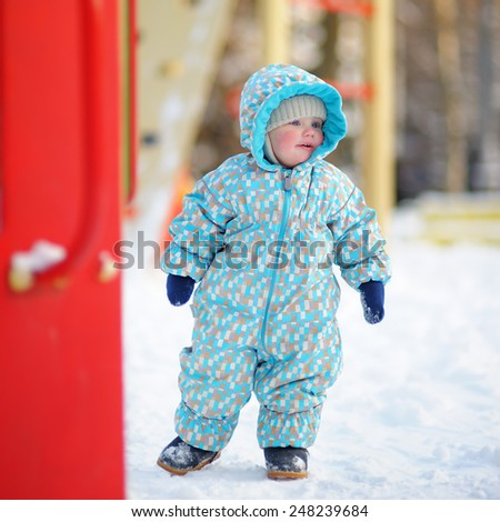 Beautiful toddler boy on playground - stock photo