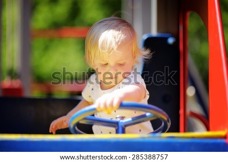 Beautiful toddler boy on playground