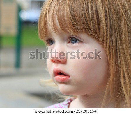 Beautiful toddler girl with red hair and blue eyes