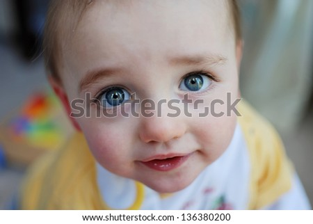 Beautiful Toddler looking into the camera - stock photo