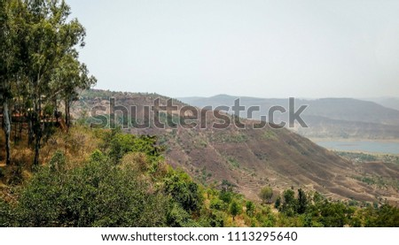 Beautiful top view of mountains hills valley and water from Parasi point in Panchgani Mahabaleshwar India