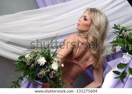 Beautiful topless girl with flowers