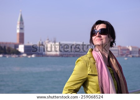 Beautiful tourist woman in Venice, exploring the old city - stock photo