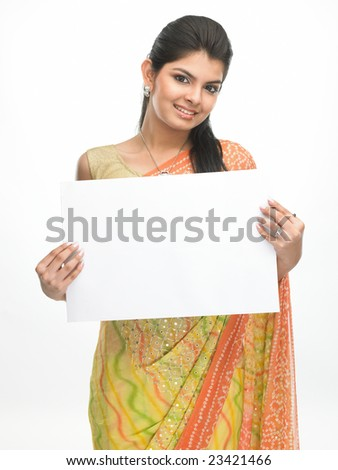 Beautiful traditional asian girl with sari holding the white placard - stock photo