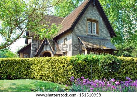 Beautiful traditional English cottage - stock photo