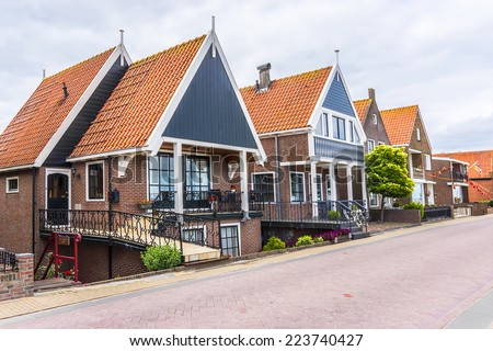 Beautiful traditional houses in a Dutch town Volendam, Netherlands. Volendam - a small town that has preserved the tradition of Dutch fishing villages.