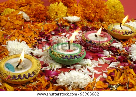 Beautiful traditional lamps lit up  in a line on the occassion of  Diwali festival in India - stock photo