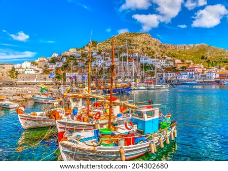 beautiful traditional wooden fishing boats at Hydra island in Saronic gulf in Greece. HDR processed - stock photo